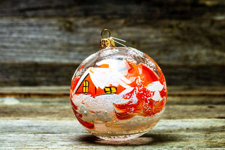 Close up of decorated glass Christmas ball bauble on wooden background, Imagens