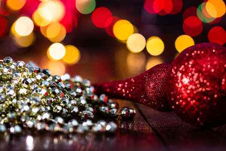Decorations and ornaments in a colorful Christmas composition isolated on background of blurred lights.
