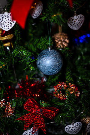 Christmas hanging decorations on fir tree. Decorated Christmas tree. Fir branch with Christmas baubles decorations. Imagens