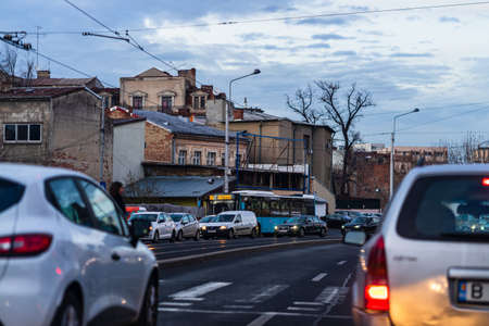 Car traffic at rush hour in downtown area of the city. Car pollution, traffic jam in the morning and evening in the capital city of Bucharest, Romania, 2021