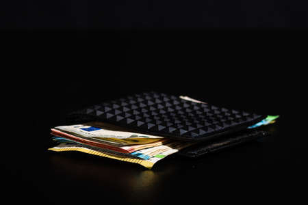 Euro banknotes in black wallet isolated.