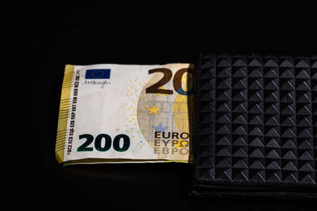 200 Euro banknotes in a black wallet isolated. Imagens