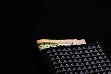 Dollars money banknotes in a black wallet isolated.