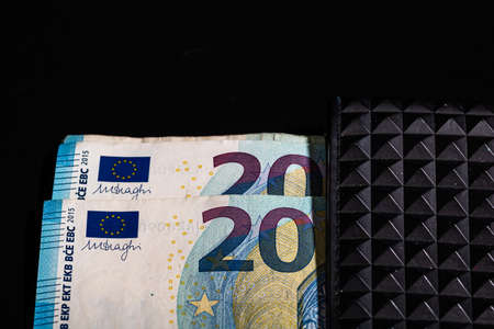 20 Euro money banknotes in black wallet isolated