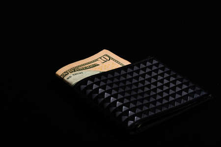 10 Dollars banknotes in a black wallet isolated Imagens