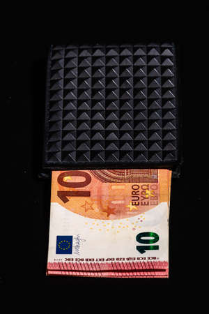 10 Euro money banknotes in blak wallet isolated