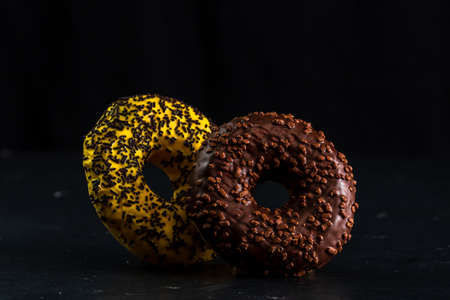 Glazed donuts with sprinkles isolated. Close up of colorful donuts. Imagens