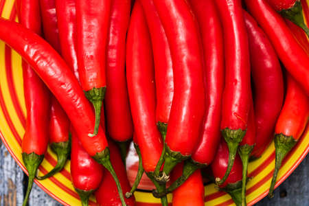 Red hot chilli peppers, close up. Background of red chilies Imagens