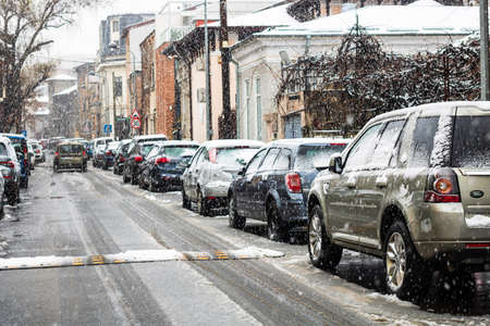 Snowing on cars in the morning, snow on street in Bucharest, Romania, 2021 Editorial