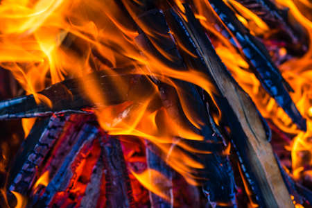 Burning wood chips to form coal. Barbecue preparation, fire before cooking. Stock Photo