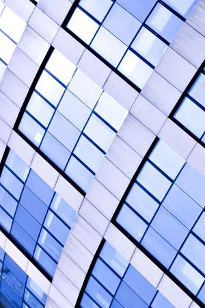 Blue abstract crop of modern office skyscraper photo