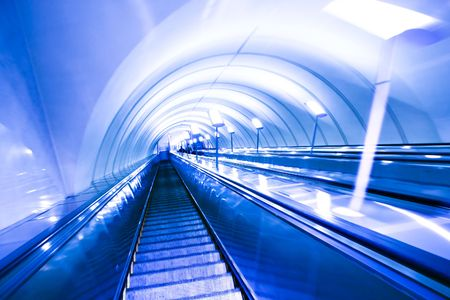 Blue move escalator in modern office centre photo