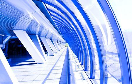 Violet glass corridor in tube bridge photo