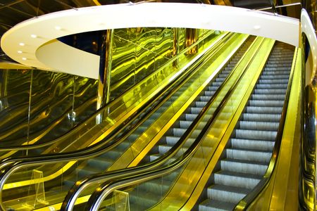 Yellow move escalator in modern office centre photo