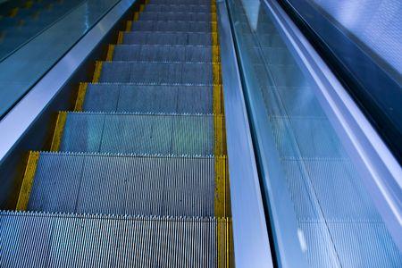 Blue move escalator in modern office centre Stock Photo - 4907930