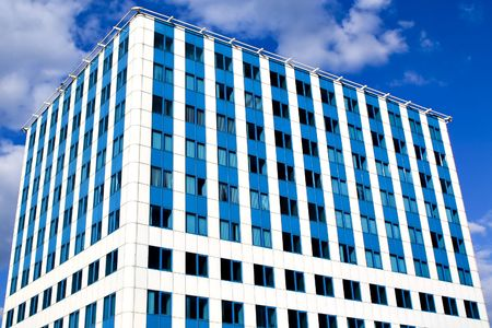 Modern blue office building corner and bright sky Stock Photo - 4909197