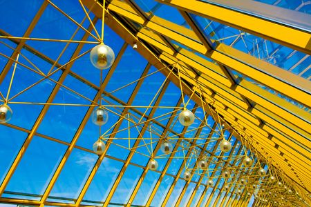 Yellow abstract ceiling in office center photo