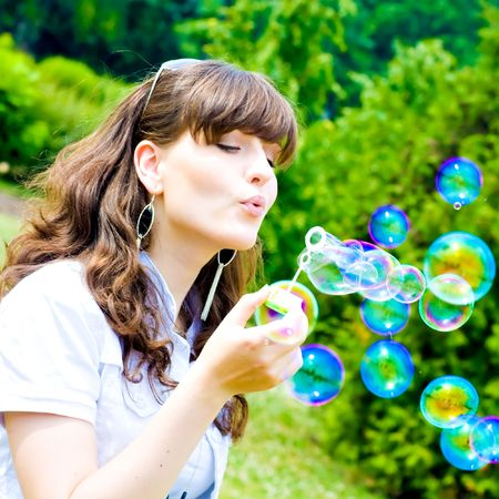 smile teen standing with soap bubbles Stock Photo - 5173649
