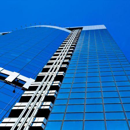 New skyscraper business center on blue sky background photo