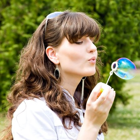 smile teen standing with soap bubbles photo