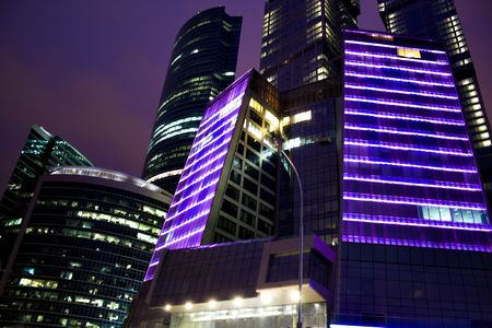 night city of business skyscrapers in beautiful violet lights photo