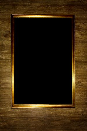 gold frame on the grungy wall Stock Photo - 5423578