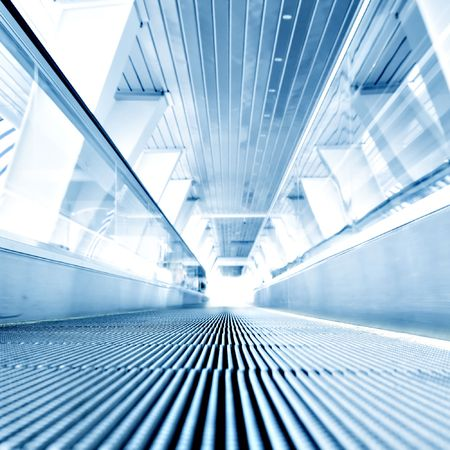 fast moving escalator in square composition photo