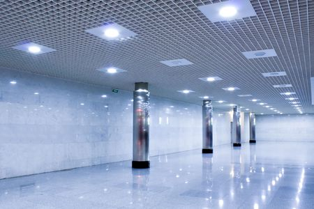 corridor in metro station with wide columns photo