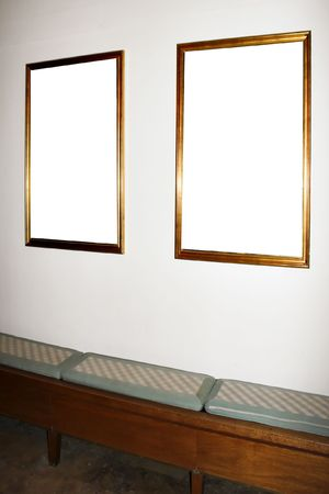 wall in museum with empty frames photo