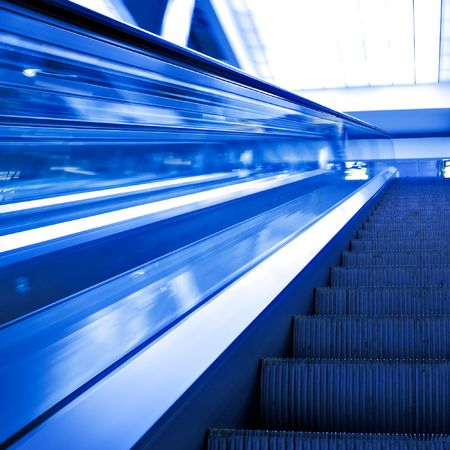 moving escalator in square composition photo