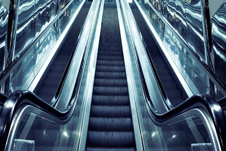 abstract dark steps of moving escalator in airport photo