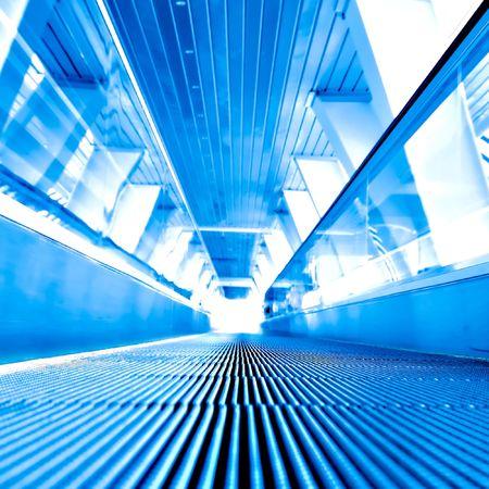fast moving escalator in square composition photo