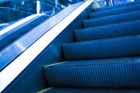 steps of moving escalator perspective view photo