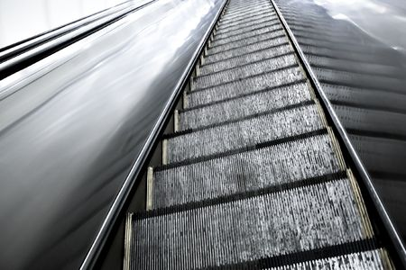Moving escalator in the metro station photo