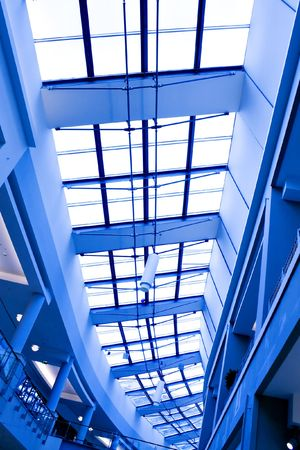 Abstract blue geometric ceiling in office center photo