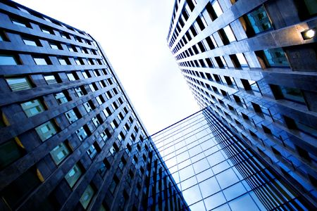 business centre: Underside view to new skyscraper business centre Stock Photo