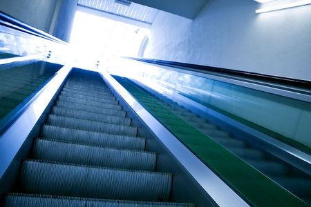 moving escalator, perspective view photo