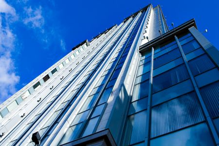 angled business skyscraper with reflection in windows Stock Photo - 5727407
