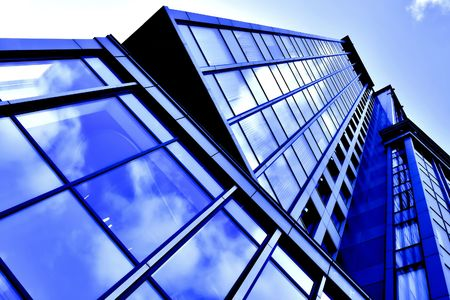 angled business skyscraper with reflection in windows Stock Photo - 5751598