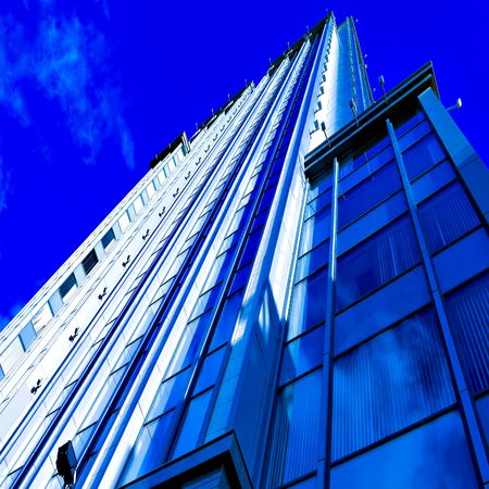 angled business skyscraper with reflection in windows Stock Photo - 5850294