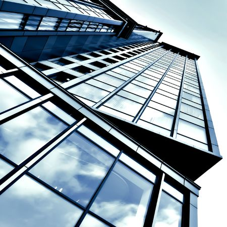 architectural exterior: angled business skyscraper with reflection in windows