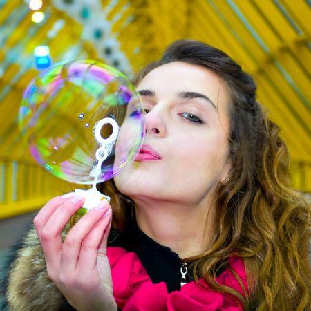 ecstasy: portrait of the beautiful blowing soap bubbles