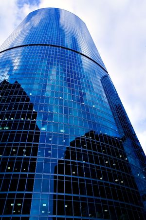 violet residential: bright blue business tower Stock Photo