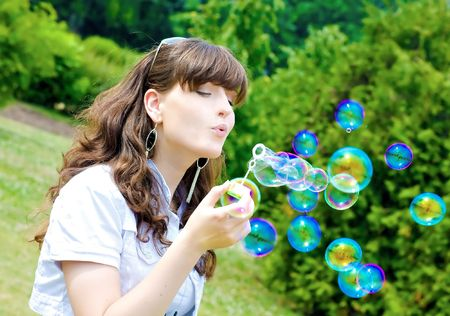smile teen standing with soap bubbles Stock Photo - 6104752