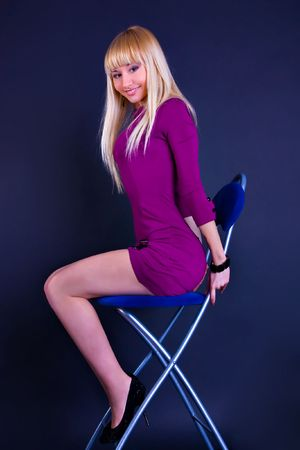 portrait of young sexy blond woman in purple dress photo