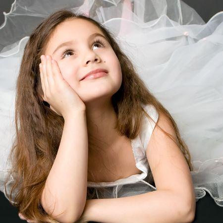 little girl dancing: beautiful dreaming girl