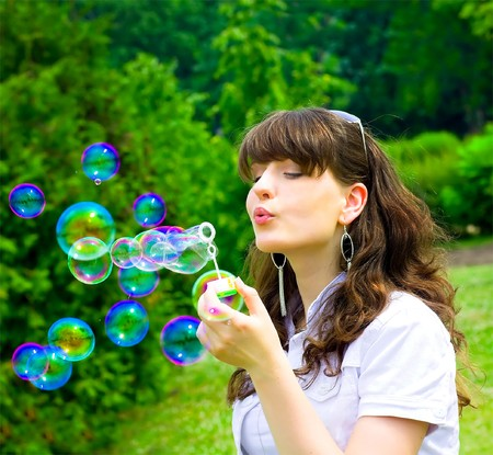 blow: active young girl with soap-bubbles Stock Photo