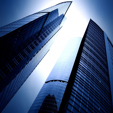 commercial property: modern glass business skyscrapers at night Stock Photo