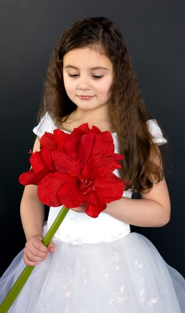nude little girls: beautiful dreaming girl with bright red flower