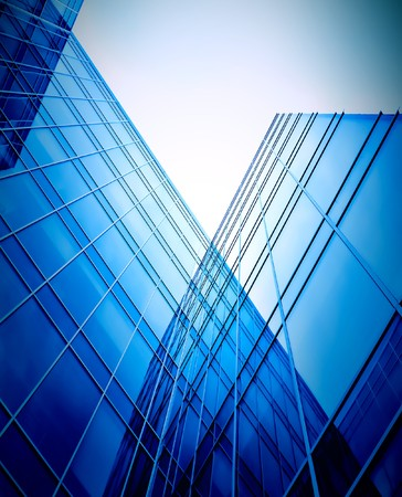 office building exterior: evening glass perspactive wall of business building corner Stock Photo